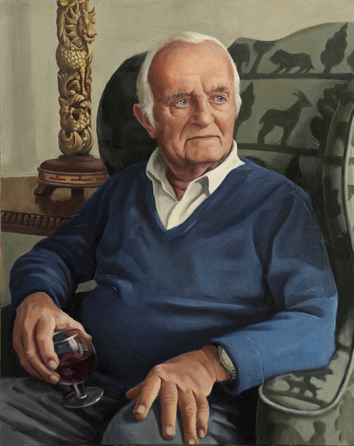 A portrait of a man in a chair holding a glass