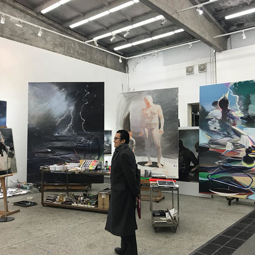 A photo of Jia Aili in his studio