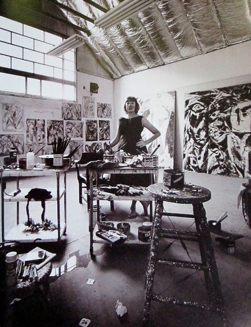 A photo of Lee Krasner at work in her studio