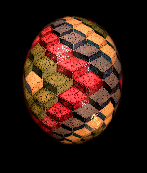 A pattern of geometric cubes painted on an ostrich egg