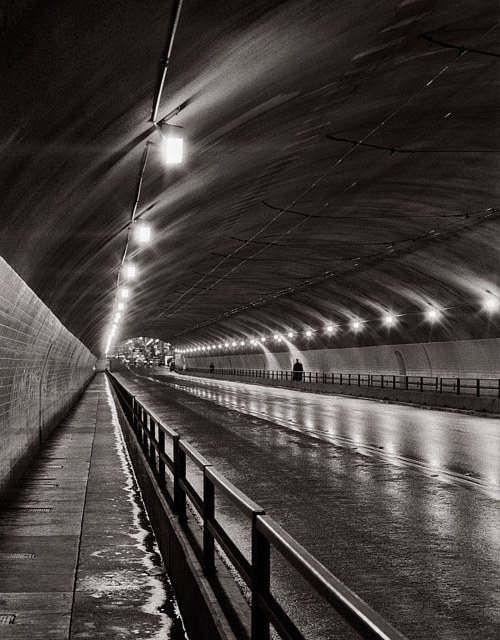 A black and white photo of the interior of a tunnel