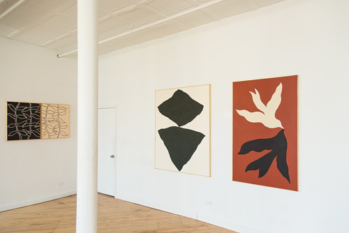 An exhibition photo of John Zabawa's paintings installed in a space