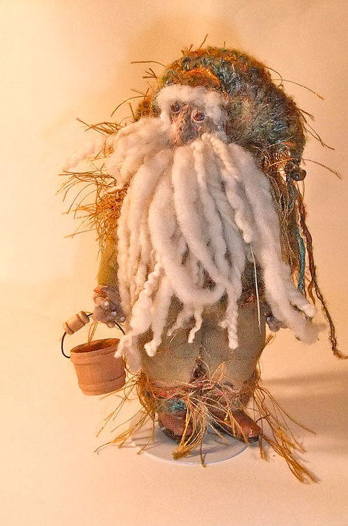 "A handmade ""woodsman"" sculptural doll"