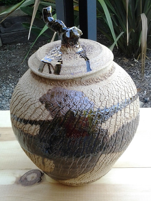 A handmade ginger jar with a natural glaze