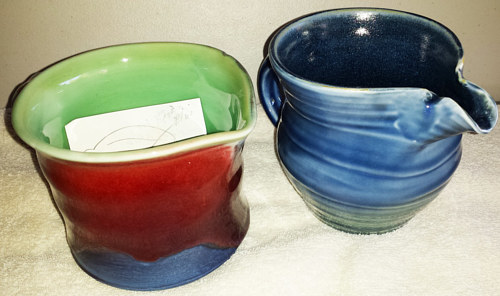 A blue pitcher and a batter bowl handmade in ceramic