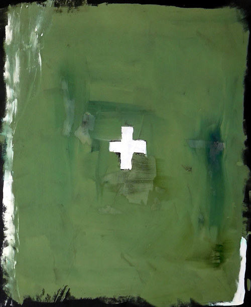 A painting of a white cross on a green background