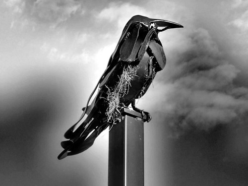 A black and white photo of a crow sculpture