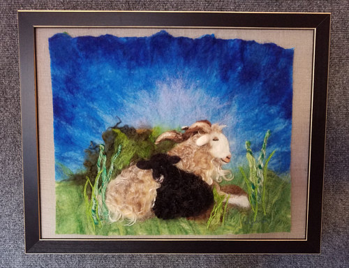 A felted image of two sheep in a field