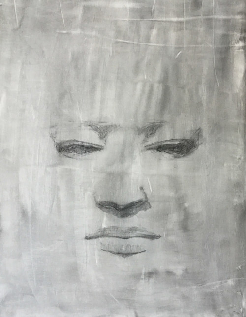 A drawing of a face with a lot of negative space