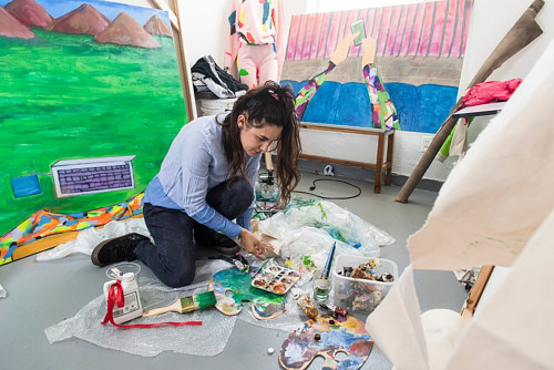 A photo of Jillian Mayer in her art studio