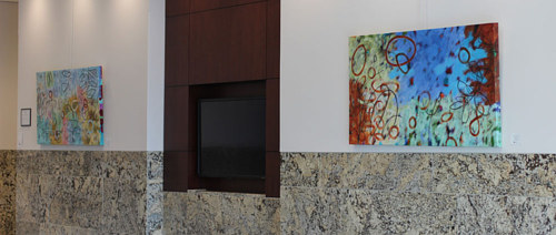A pair of artworks by Addison Paige installed in a county commissioner's office