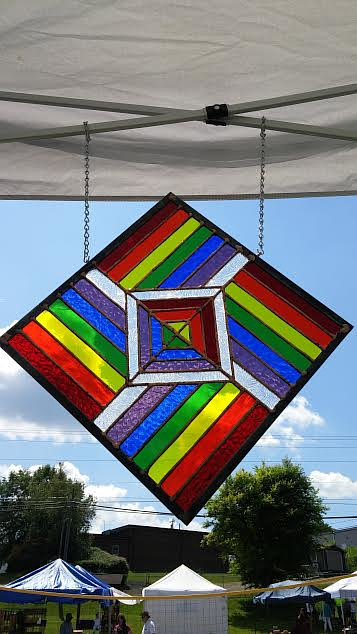 A photo of a rainbow stained glass artwork