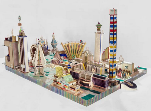 A diorama of a complex city made with discarded paper and materials
