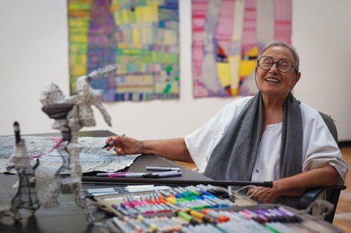 A photo of Huguette Caland in her studio