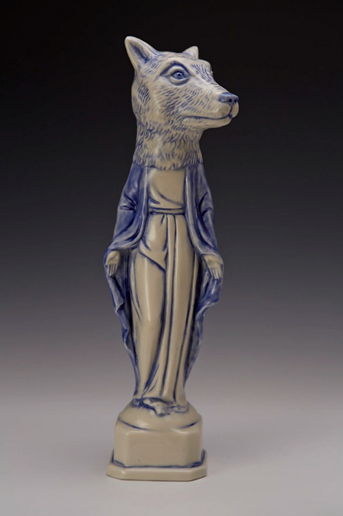 A ceramic figure of a Madonna with the head of a wolf