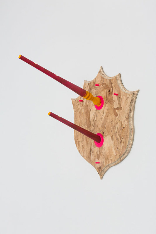 A sculptural artwork with a particleboard shield
