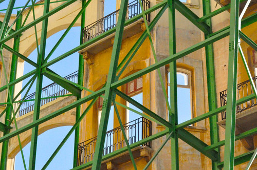 A photo of bright green scaffolding in front of a building