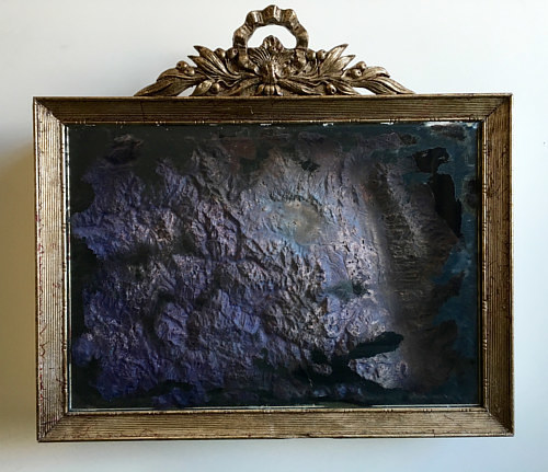 An artwork made up of textured paper pulp in a frame