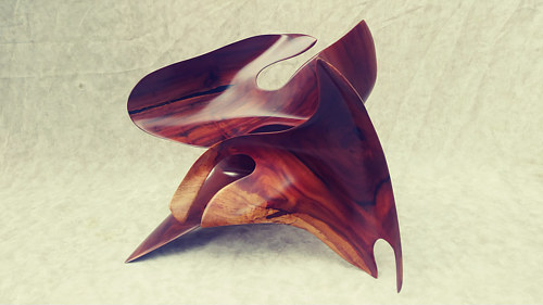 A wood sculpture made using dynamic abstract shapes