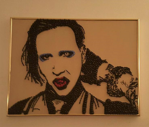 A portrait of Marilyn Manson made in coffee beans