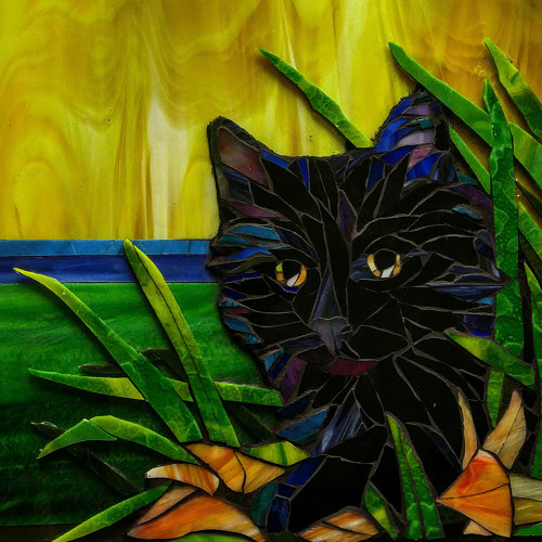 A stained glass mosaic of a black cat