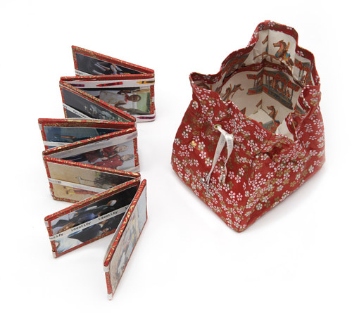An artwork consisting of a cloth bag and a Jacob's ladder with photographs