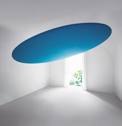 A blue circular painting positioned on a ceiling