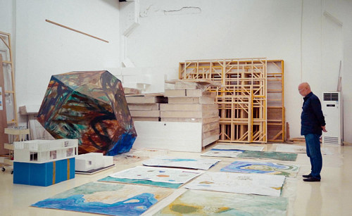 Zhang Enli observing a large painting in his studio space