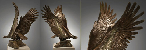 A bronze sculpture of a condor with its wings spread