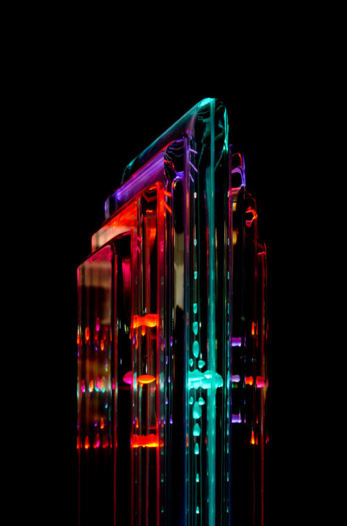 A piece of glass art with translucent neon colours