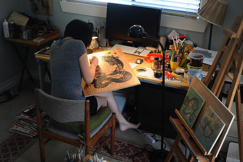 Photo of artist working in her art studio