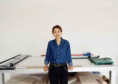 A photo of Minouk Lim in her art studio