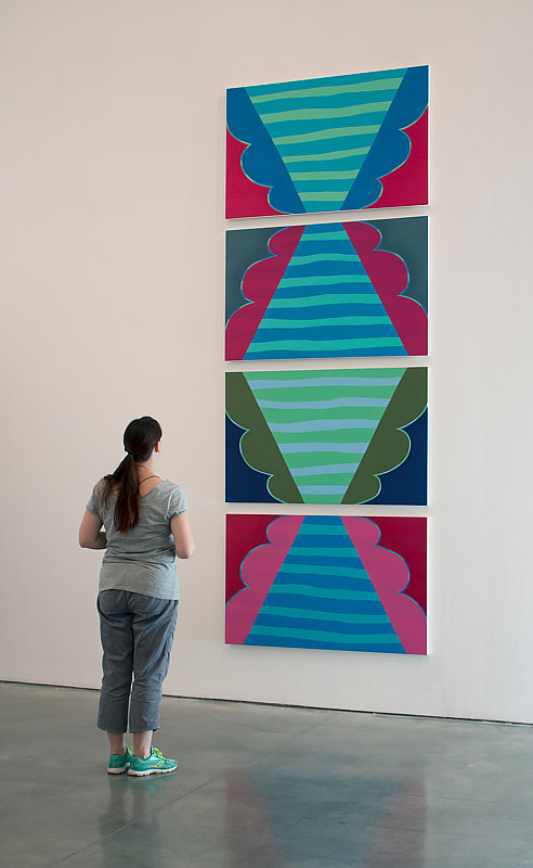 A series of four paintings of stripes and coloured bump shapes