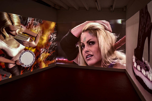 An installation view of a three-channel video