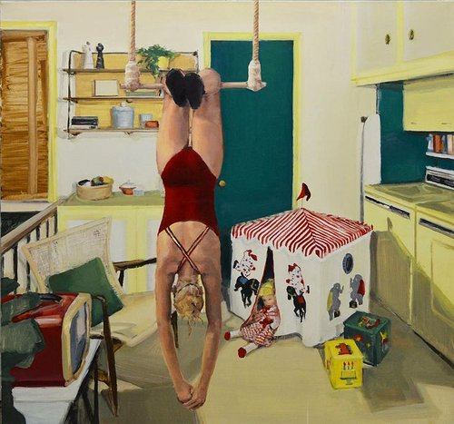 Figure hanging upside down from trapeze in the middle of kitchen
