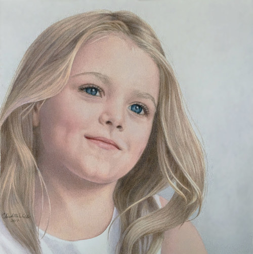 A drawing of a young girl with blonde hair