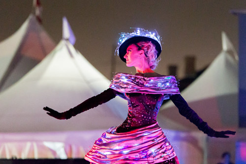 A photo of a model wearing a dress with fibre optic attachments