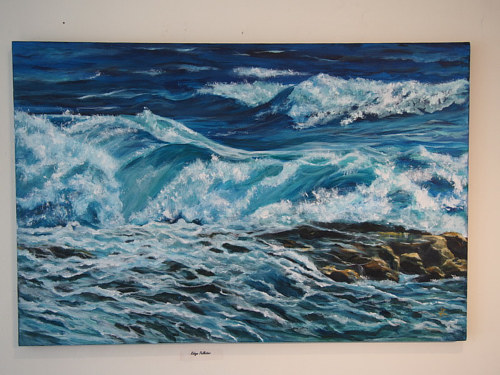 A painting of waves crashing on a beach