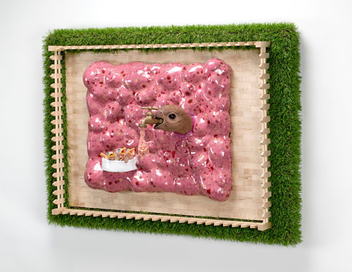 A wall-hanging sculpture using elements of livestock animals and plants