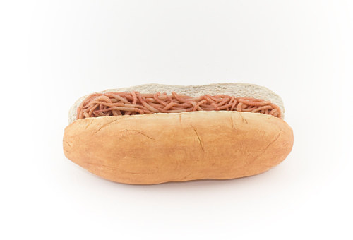 A sculpture of a hotdog bun filled with worms