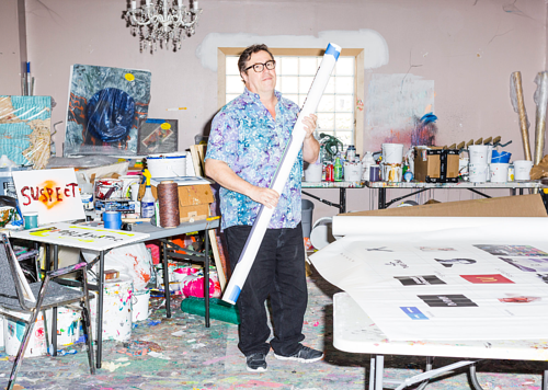 A photo of Mark Flood at work in his art studio