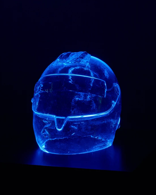 A sculpture of a racing helmet made in glass