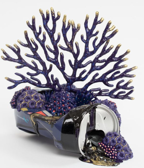 A sculpture of coral growing on a discarded can