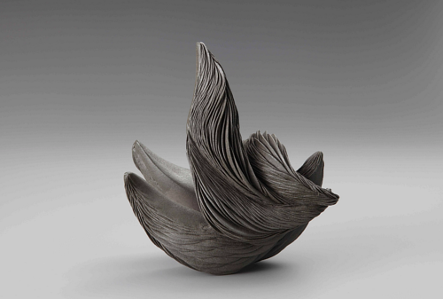 A charcoal-coloured abstract ceramic artwork