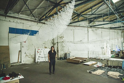 A photo of artist Chiharu Shiota working in her Berlin studio