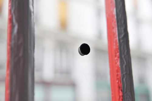 An art installation consisting of a black dot obscuring part of a window