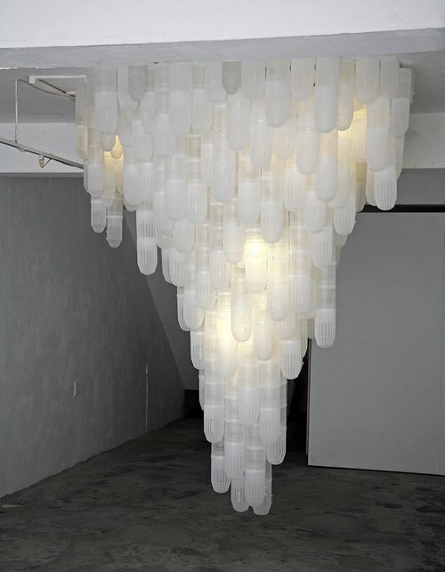 A sculptural installation of hanging shrimp traps