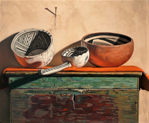A still life painting of Mexican artefacts posed on a table