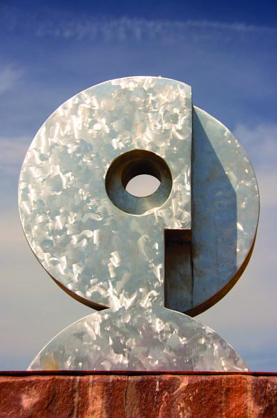 An aluminum sculpture with a rounded shape