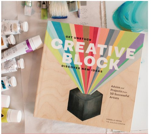 Photo of art supplies with book titled Creative Block